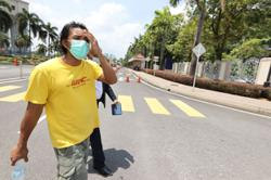 Man in viral video with nasi lemak seller charged with failing to wear mask