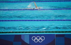 Olympics-Swimming-Americans face double threat to dominance in the pool