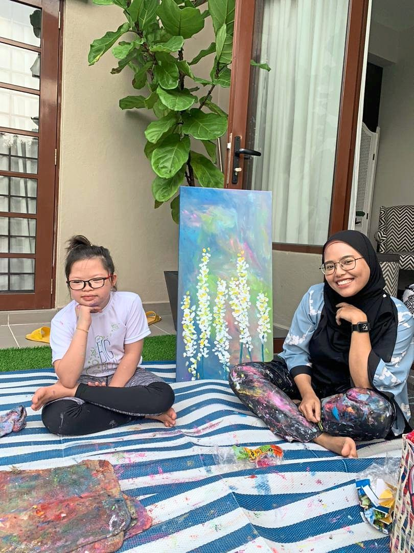 Art teacher Nik Nur Izzati (right) brings out the best in Maryam's artistic skills.