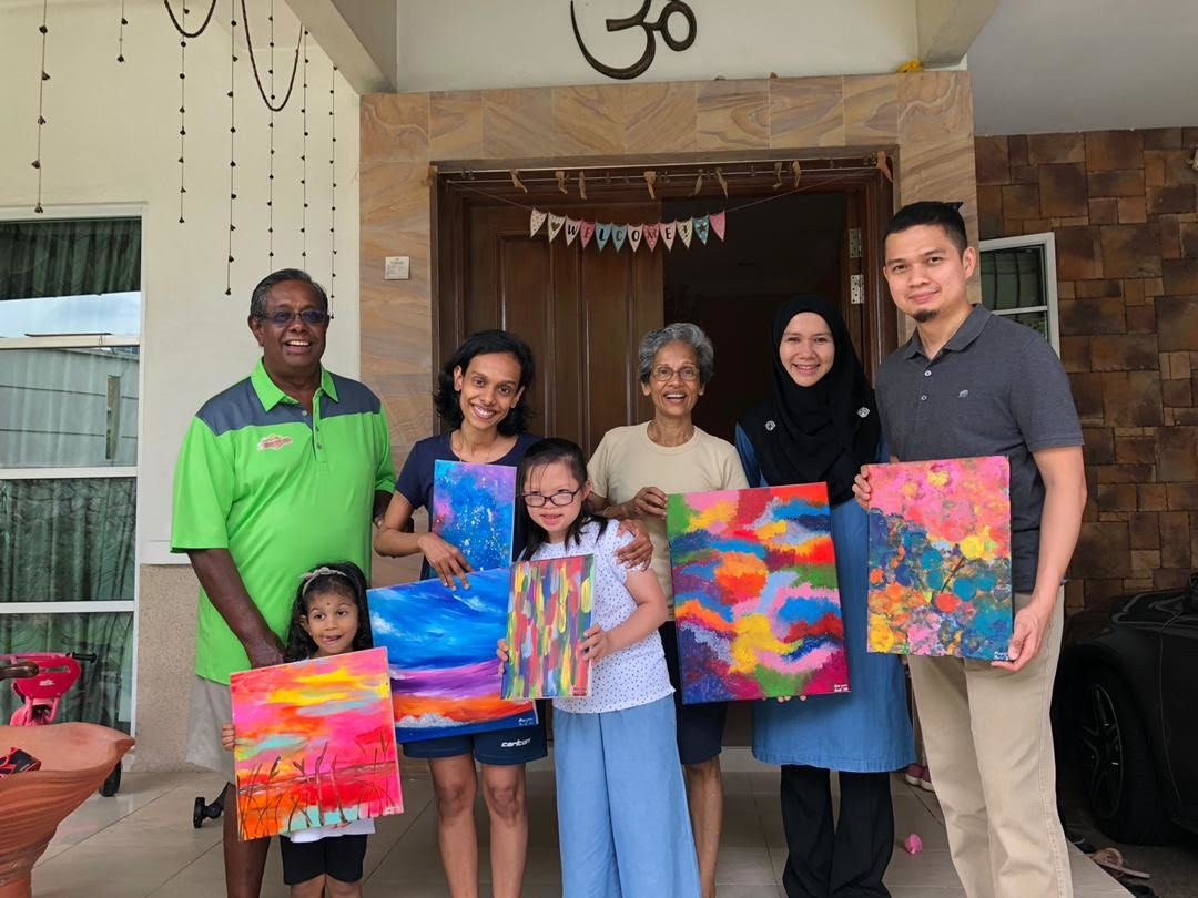 Dr Khairul Anuar (right) and his wife Sharifah Sarah (second from right) are proud of their daughter Maryam's artistic talents.