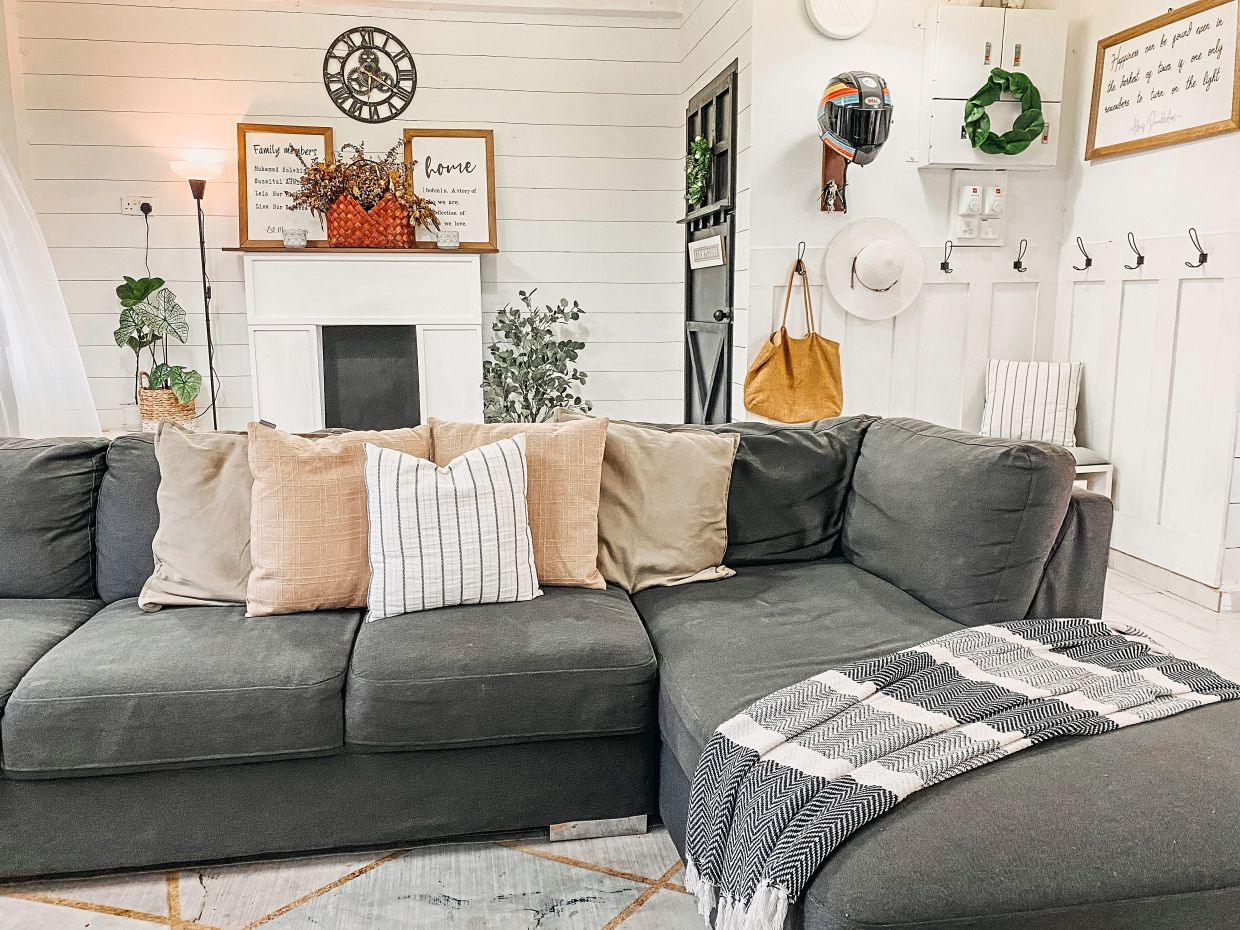 The couple's transformation project resulted in a country farmhouse setting in white, grey, green and natural wood tones, incorporating new furniture and decor items that were mostly made by hand.