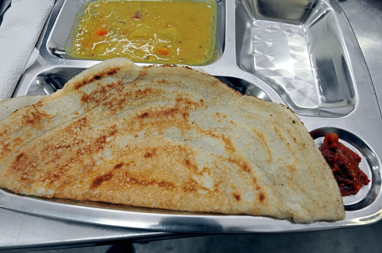 Thosai with dhal curry is a good choice for a plant-based breakfast. — Filepic