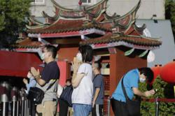 Taiwan to ease Covid-19 restrictions as cases drop