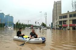 Villagers flee fresh floods in central China as typhoon In-fa approaches
