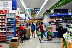 Singapore full-year inflation forecast raised to 1-2%; core inflation eases to 0.6% in June