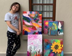 Nine-year-old Malaysian Down Syndrome artist raises RM80,000 to help needy kids