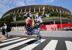 Olympics-Tradition, fireworks and a moment of silence as Tokyo Games start