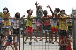 Philippines orders children back indoors amid fears of virus surge