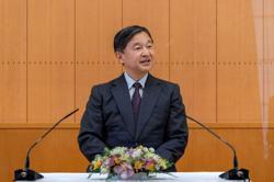 With subtle language change, Japan's emperor 'commemorates' solemn Games