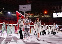 Olympics-Mask-shy Kyrgyzstan, Tajikistan rain on COVID-compliant opening parade