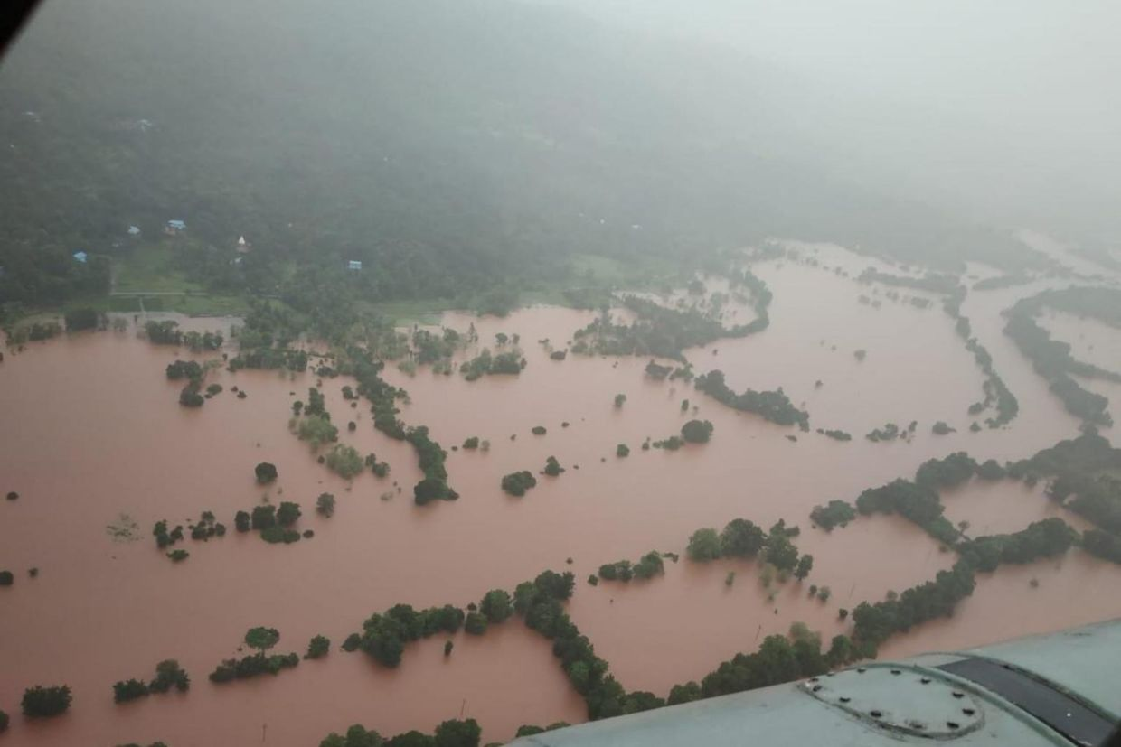 Villages in low lying areas inundated after heavy monsoon rains in Ratnagiri, district of Maharashtra, on July 22, 2021. - AFP