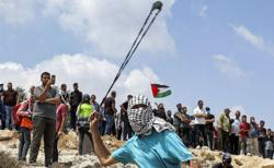 Israeli troops kill Palestinian teen in West Bank clash, say officials