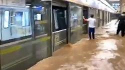 China floods: rail passengers tell of rising water and last goodbyes
