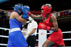 Olympics-Boxing-World champ Petecio takes step toward maiden women's gold