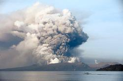 Philippines lowers alert level for volcano that has displaced 21,000