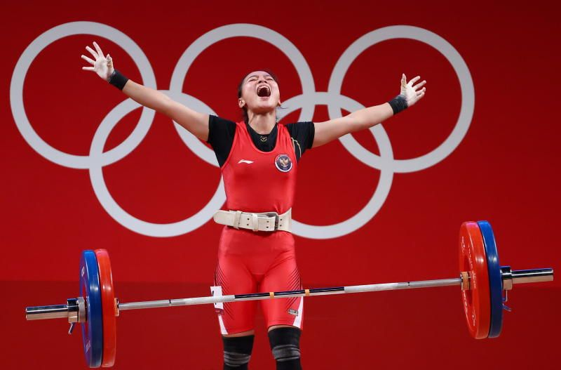 Indonesia's Aisah Windy Cantika reacting while competing in the women's 49kg weightlifting competition during the Tokyo 2020 Olympic Games at the Tokyo International Forum in Tokyo on Tuesday, July 24, 2021. - AFP