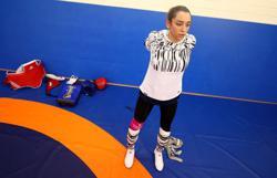 Olympics-Taekwondo-Iranian refugee defeats ex-compatriot in quest for second taekwondo medal