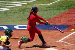 Olympics-Softball-Japan toast Canada in extra frame to set up final with U.S