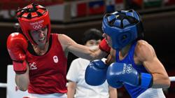 Olympics-Boxing-Bujold loses opening bout in Tokyo but leaves a mark