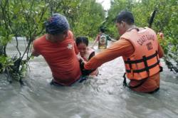 Three dead, thousands evacuated as monsoon rains batter the Philippines