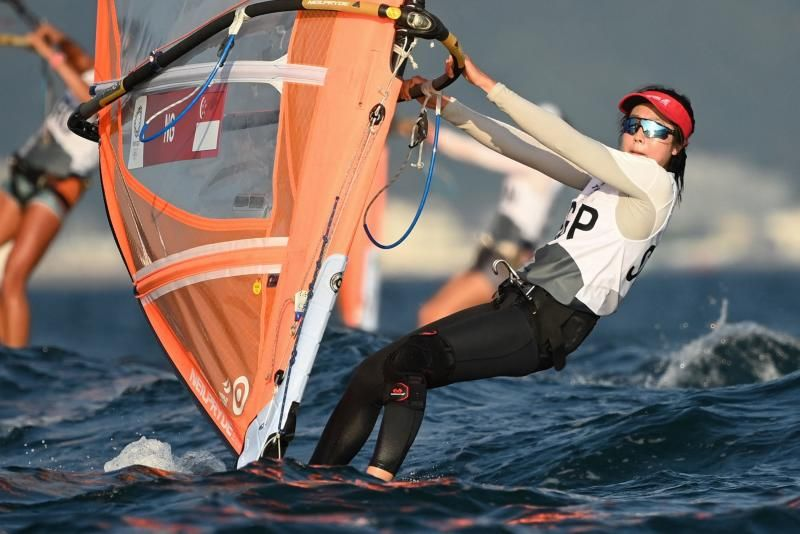 Singapore's Amanda Ng competes in the women's windsurfer RS:X race 1 during the Tokyo 2020 Olympic Games sailing competition at the Enoshima Yacht Harbour in Fujisawa, Kanagawa Prefecture on Sunday, July 25, 2021.- AFP