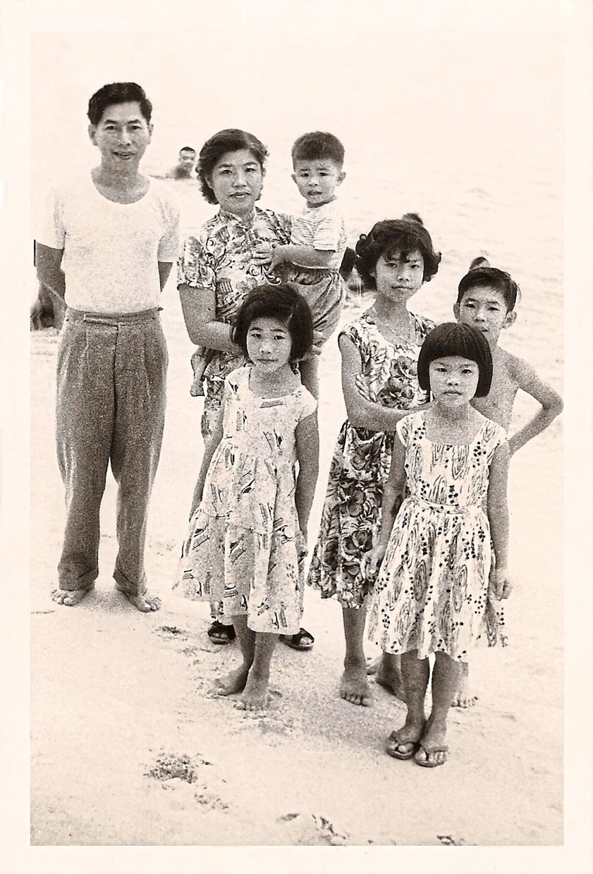 Author Choo (tallest girl) with four of her siblings and father, Choo Sen Lee, and mother, Rose Loh Piang Keow. Photo: Josephine Choo