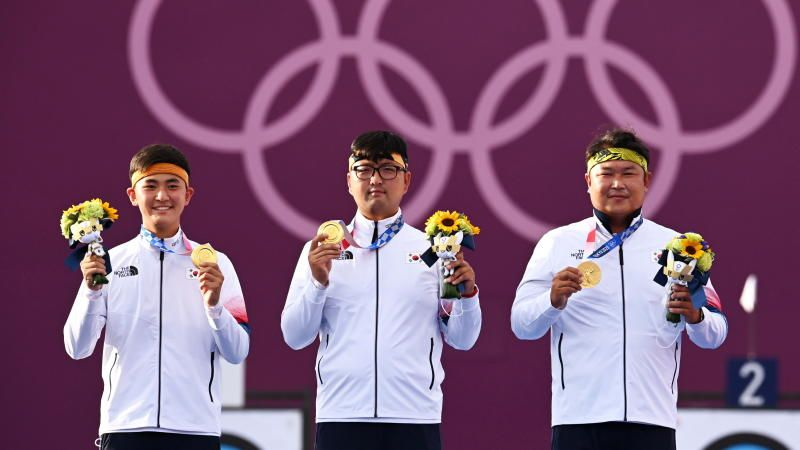 South Korean super archers ... (from left) Team gold winners Kim Je-deok, Kim Woojin,Oh Jin-hyek celebrating on the podium at the Tokyo 2020 Games on Monday (July 26, 2021). - Reuters