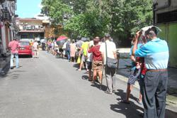 Signs of desperate times as elderly queue for food aid