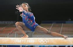 American great Biles fails to qualify for uneven bars final