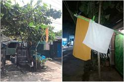 Residents hang yellow flags to call for aid