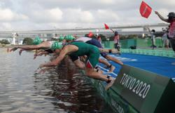 Olympics-Triathlon-Boat ahoy! Men's race start messed up by floating cameras