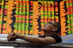 Foreign funds' net selling slows