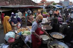 Indonesia's easing of Covid-19 curbs seen driven by economics