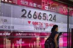 Asian stocks mostly lower after Wall Street highs, Covid-19 worries