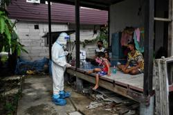 Think tank cuts Thailand's 2021 growth forecast as Covid-19 infections surge