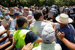 Faultlines re-open as Tunisian president's supporters and opponents clash outside parliament
