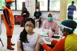 Indonesia reports 28,228 newly-confirmed Covid19 cases, 1,487 new deaths as govt announce new virus measures