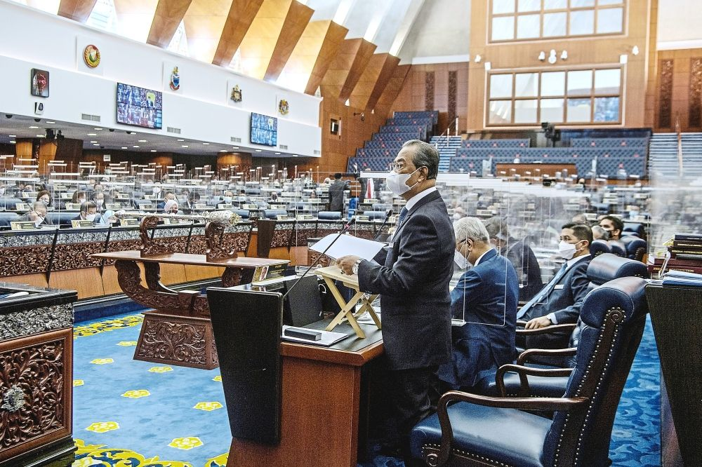 All ears: Prime Minister Tan Sri Muhyiddin Yassin making a statement on the National Recovery Plan at the special sitting of the Dewan Rakyat yesterday