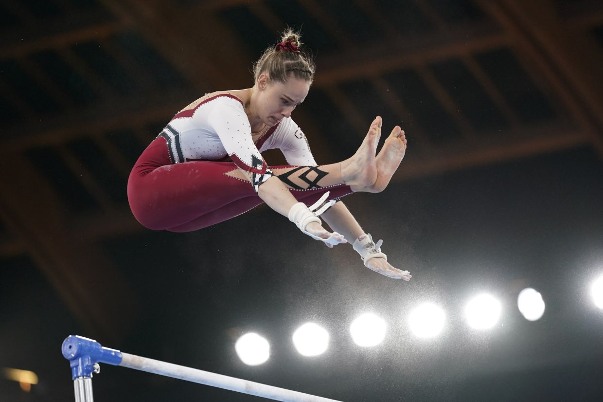 Sarah Voss, of Germany, performs on the uneven bars during the women's artistic gymnastic qualifications. Photo: AP