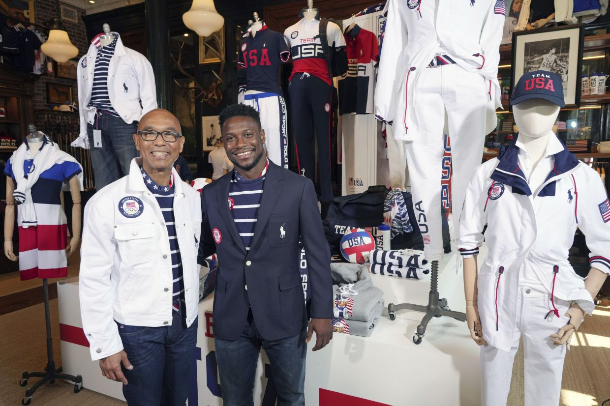 Olympic medalists in fencing, Peter Westbrook, left, and Daryl Homer model the Team USA Tokyo Olympic opening ceremony uniforms. Photo: AP