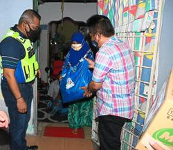 Council distributes food baskets to 36 families
