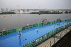 Olympics-Storm remains threat, bringing rain as it lurks off coast