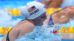 Olympics-Swimming-American Jacoby wins gold in women's 100m breaststroke