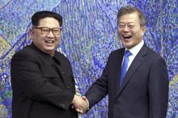 Two Koreas restore severed communications in surprise thaw
