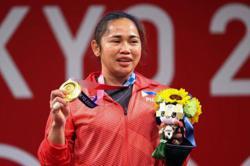 Sacrifice, exile in Malaysia: How Filipina Hidilyn Diaz made Olympic history