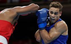 Olympics-Boxing-New Zealand's Nyika bitten but not beaten on Games debut