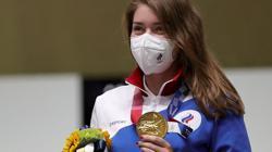 Olympics-Shooting-Avid gamer Batsarashkina flaunts medals and medallion