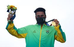 Olympics-Surfing-Ferreira completes long ride from cooler lid to gold
