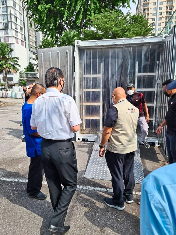 The mobile cadaver freezer arriving at Hospital Kuala Lumpur.