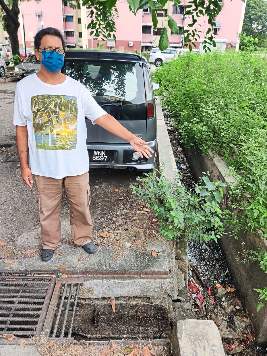 Baradhan pointing out the broken grilles and clogged drains.